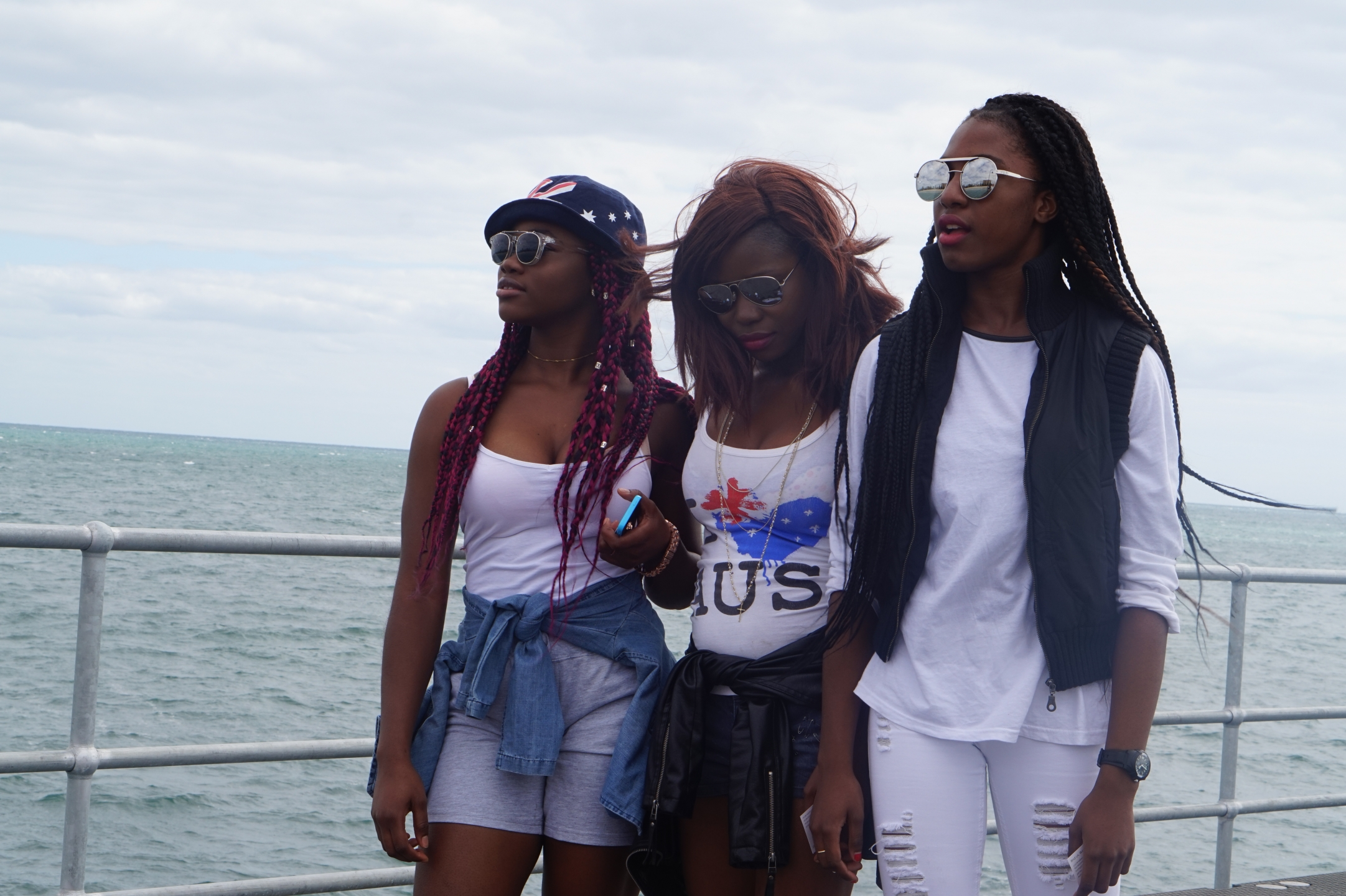 "SA: Flora Nsimba & Laelle, students, at Glenelg: ""We buy everything from the local shops""."