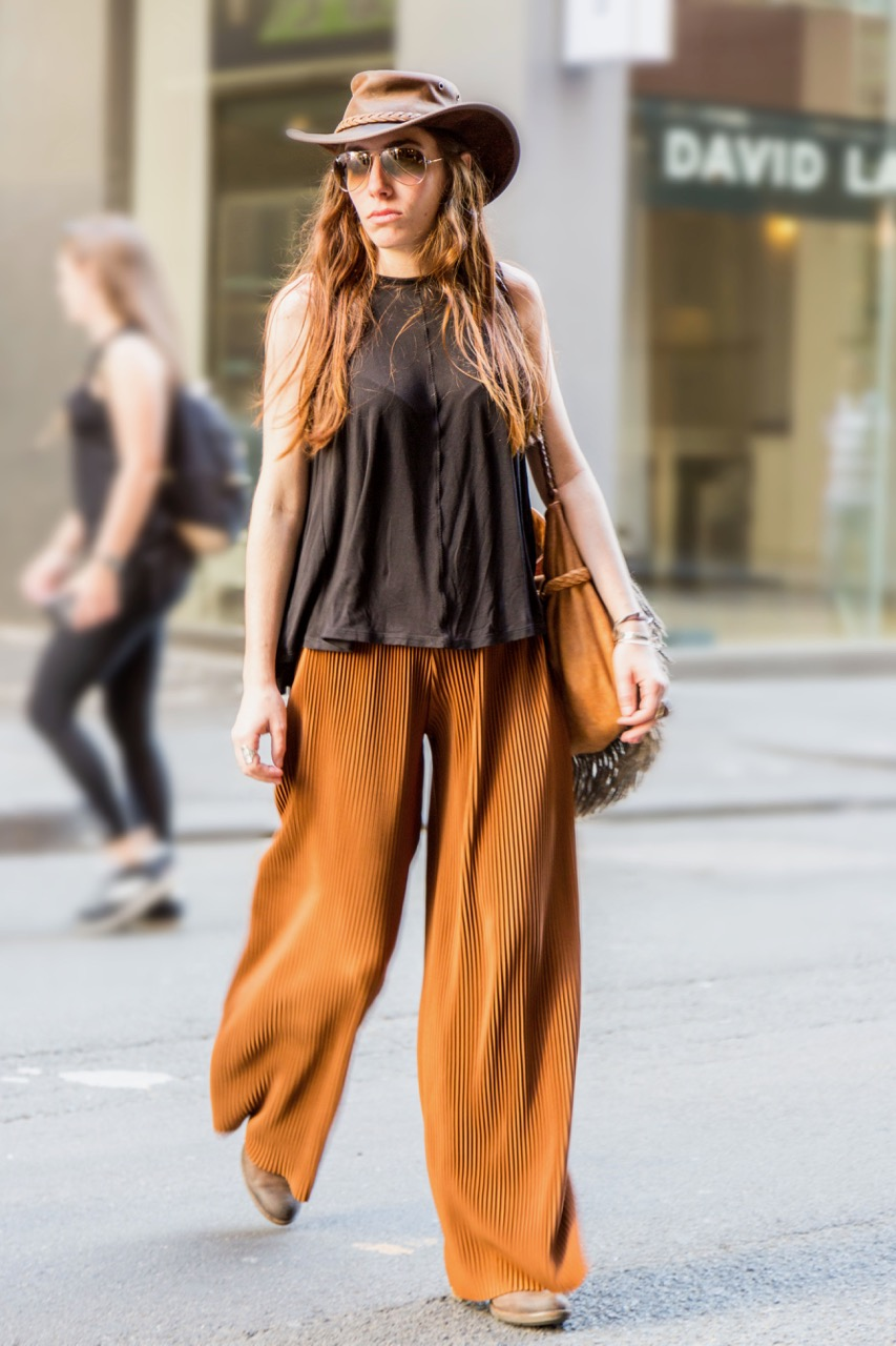 """VIC: Charlotte Vignau, French tourist, Little Bourke St. """"At the moment I love burnt orange, and I wear my hat every day, its my signature."""" Photo: Libby Matson"""