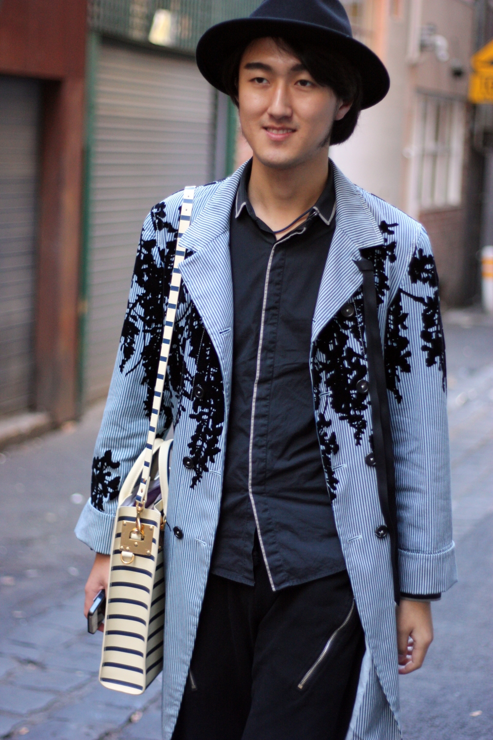 "VIC: Student, Neil Feng, Little Lonsdale St, Melbourne. ""I 'd say my style is simple and different"". Photo: Mary Tham"