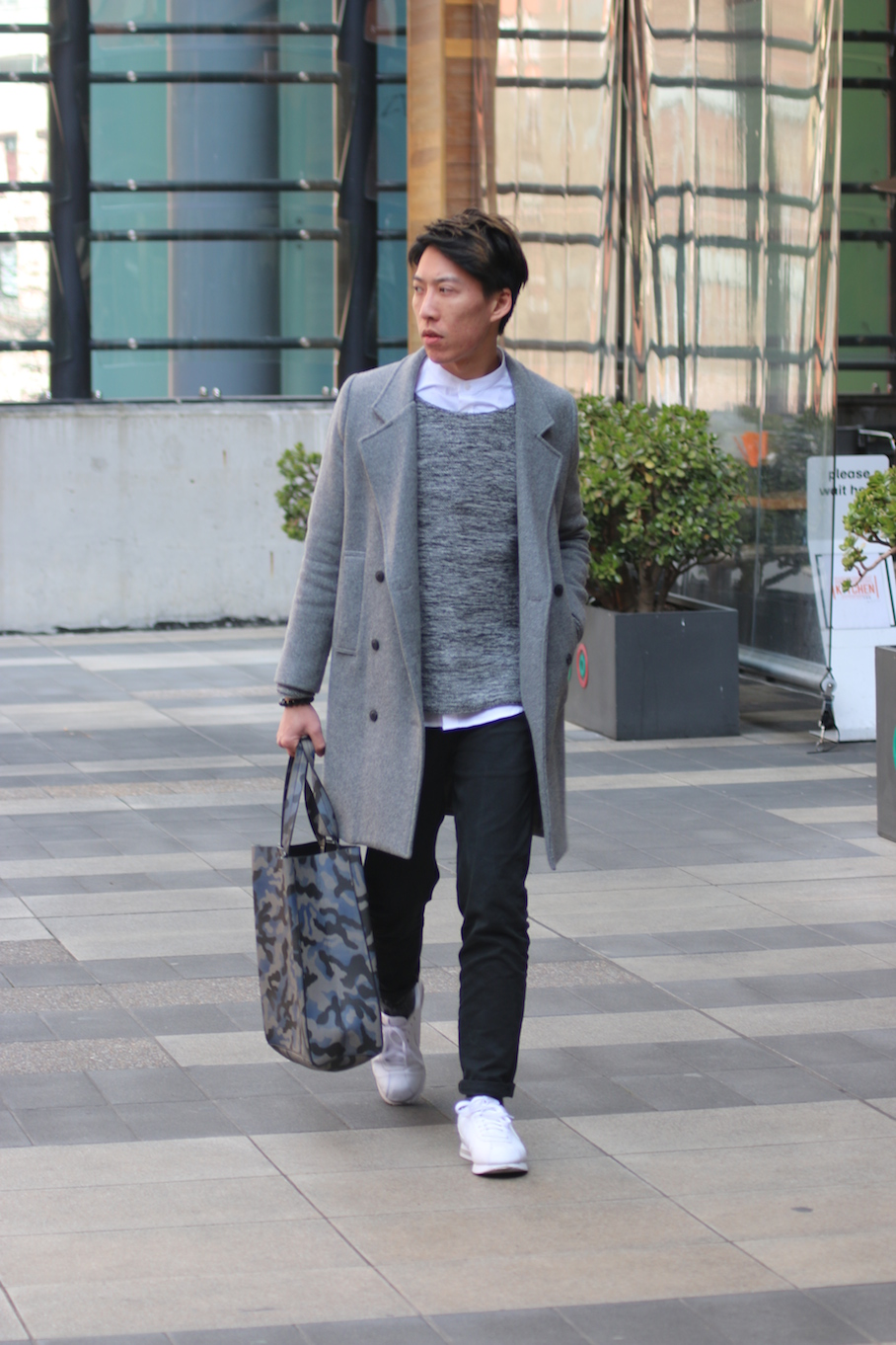 """Vic: Dio Chui, Psych Student, QV Square, Melbourne. """"My style is fashionably street – but smart."""" Photo: Tracie Sullivan."""