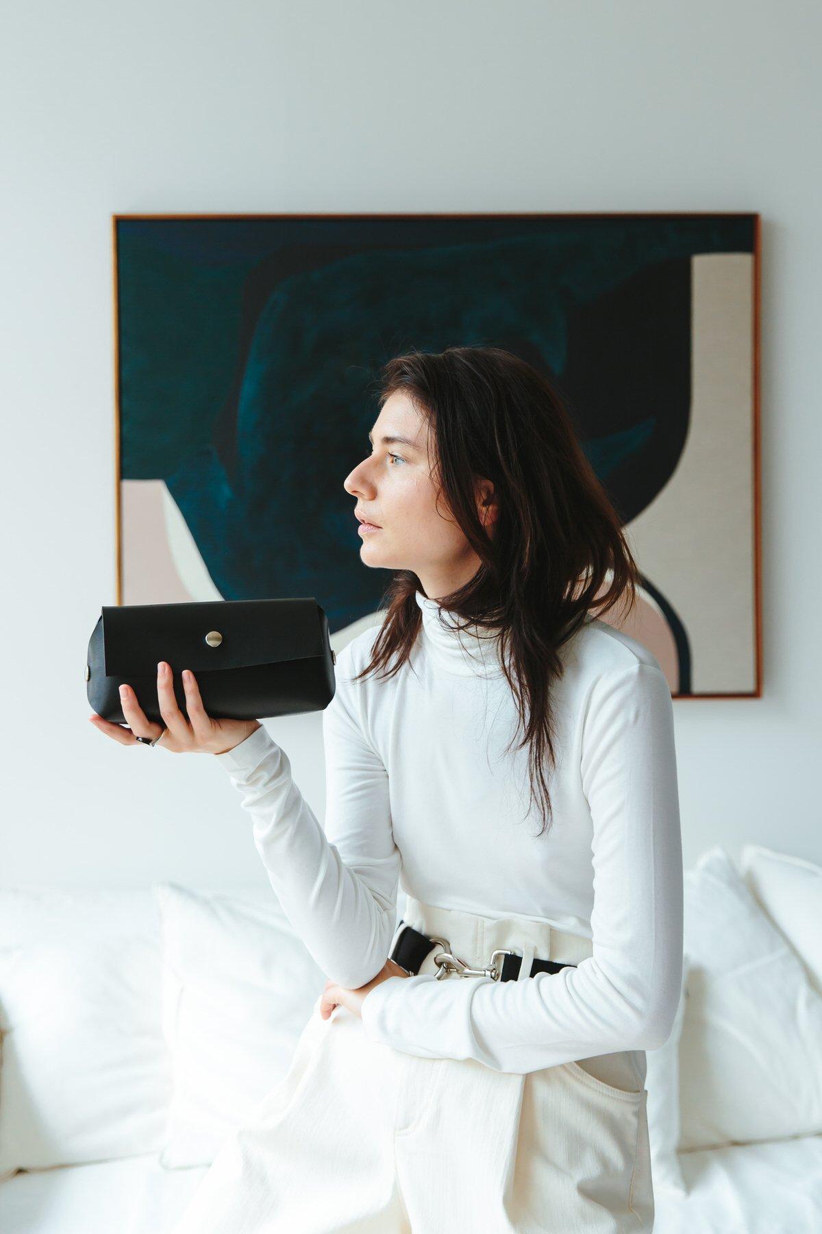 Designer Katya Komarova holding one of her designs