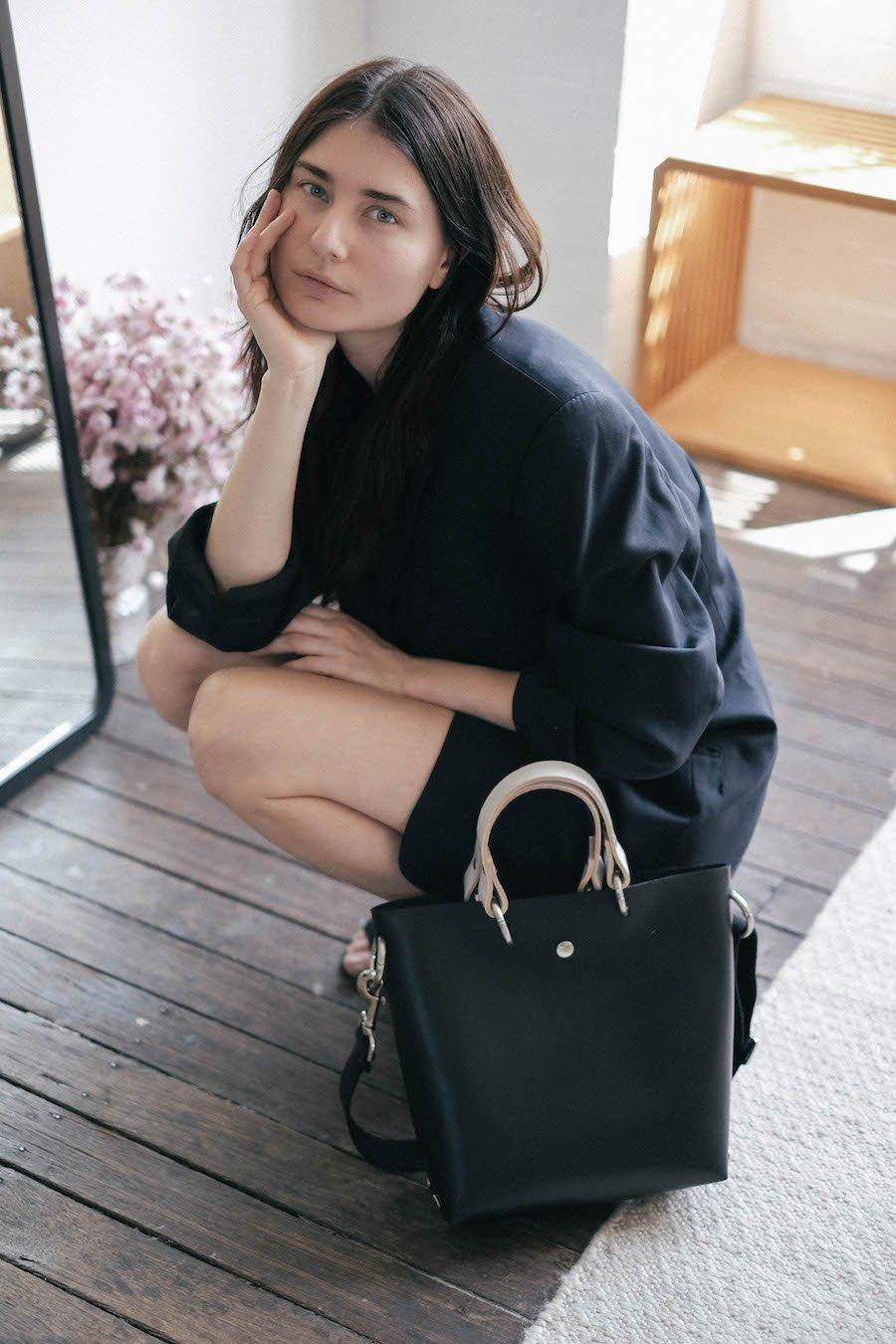 Katya Komarova posing with one of her pieces