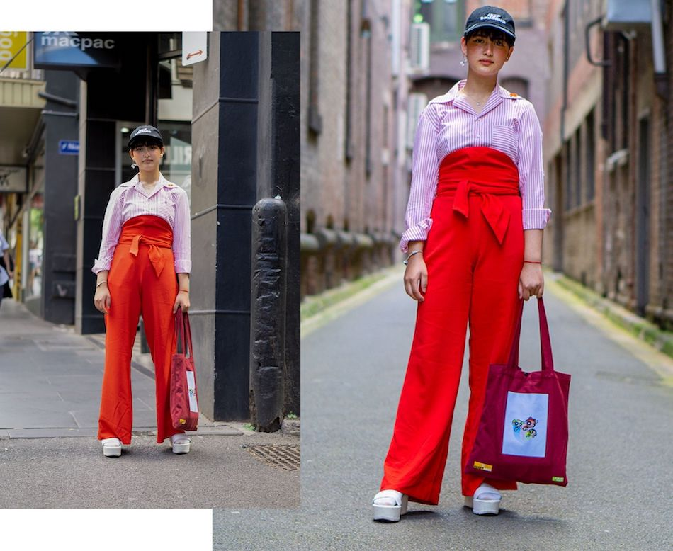 street fashion photo - woman in cap and high waisted pants