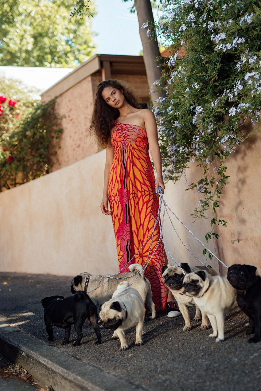 Keana and 6 pugs model from Red Opium's Chirriger Collection to welcome in the Year of the Dog