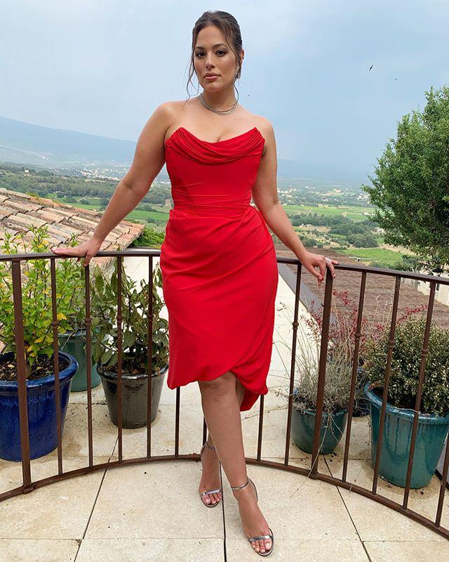 Ashley Graham in below the knee hem length dress