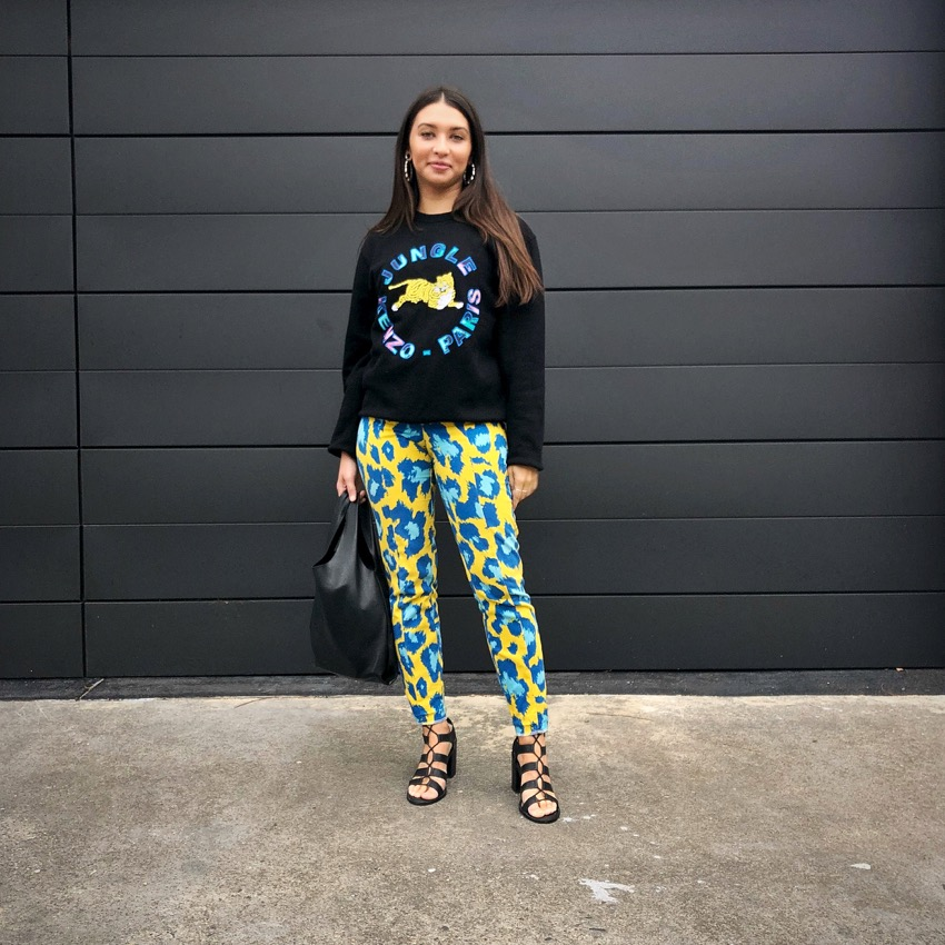 """Melbourne: Ebony, Graphic Designer, """"I guess this jumper is to be expected from the people who see me catwalk around work all day."""" Photo: Kevin Colombu."""