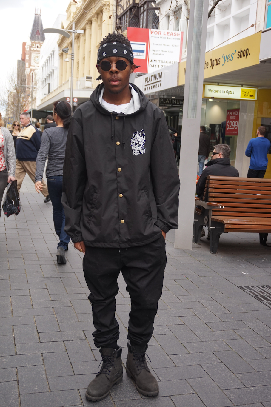 """WA: Emmanuel_Obidike, student, Hay St, Perth. """"I'm just chillin' out with my friends."""""""