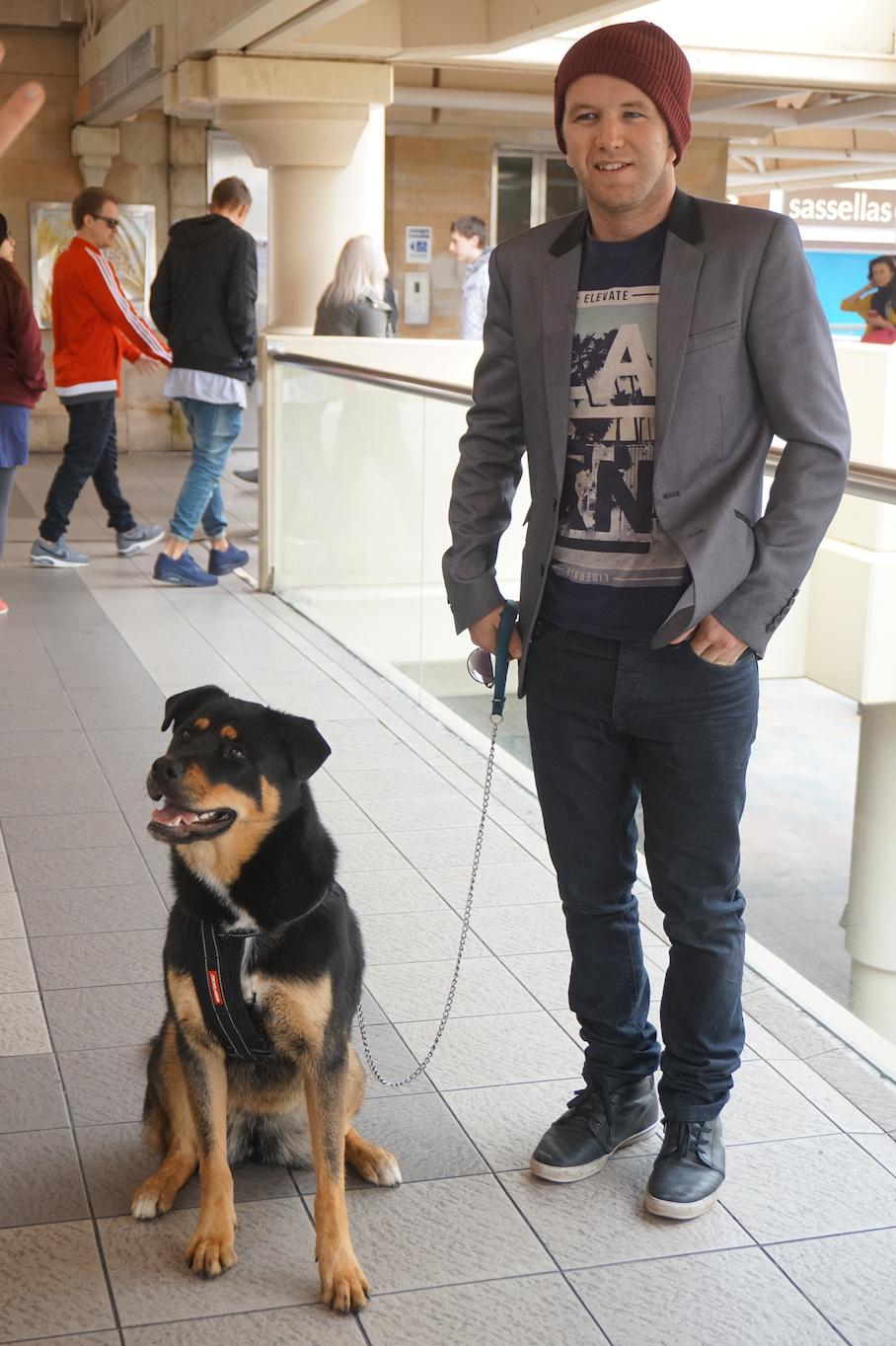 """WA: Sam Mercer (L) & Rooby Doo, Perth City. """"I take my dog everywhere, even to work."""""""