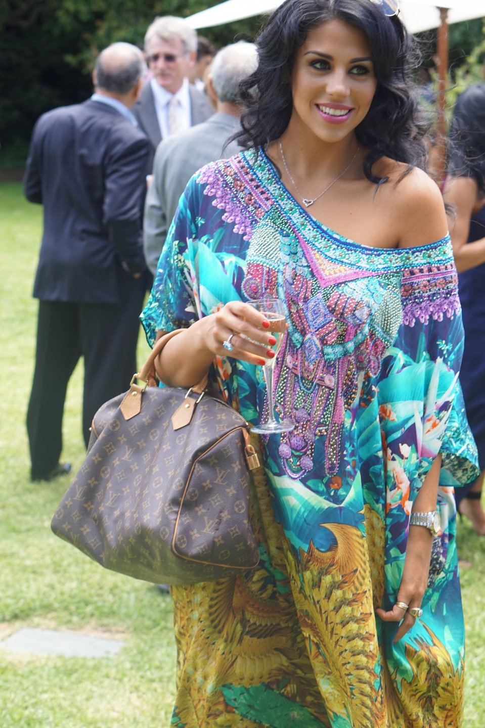 "Vic: Filea Tsapepas, Make-up Artist, at a garden party, South Yarra. Wearing ""the Unseen World"" ""I love glitz and glamour, sophistication, make-up and classic charm."""