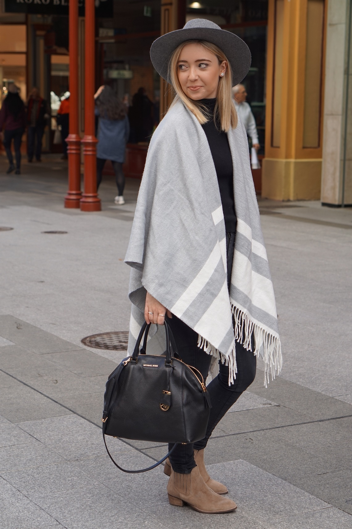 "SA: Claire McNally, retail manager & blogger, Rundle Mall. ""I'm totally in love with grey this season."""