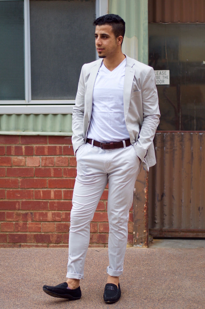 "SA: Ayman Kasim, Project Engineer, Labels Style Markets, Bowden. ""I wasn't expecting someone to take my photo."""