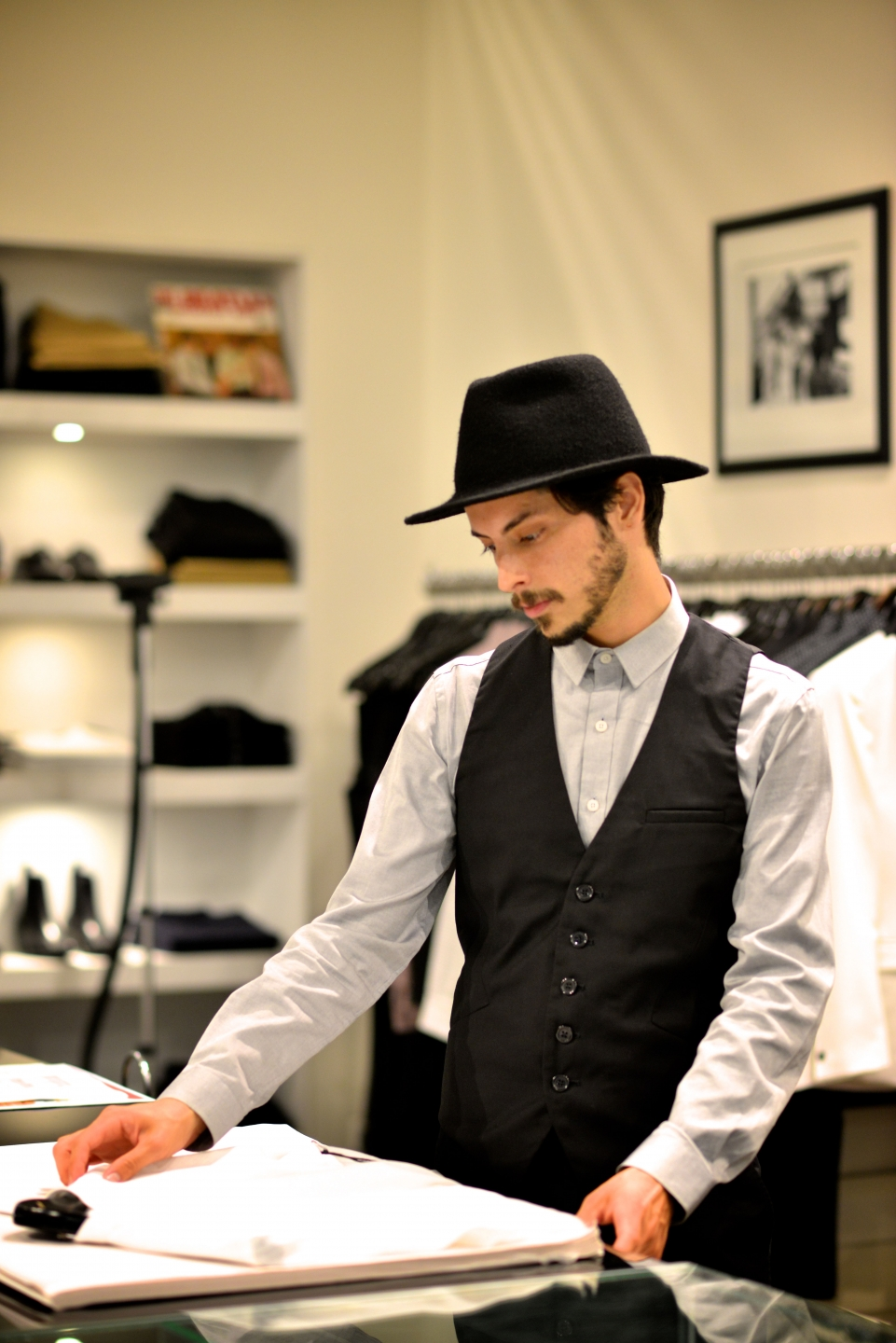 "WA: Nicky Paez at work in fashion retail, Perth. ""My style is streetstyle mixed with old fashioned attire and influence."" Pic: Alan Wu"