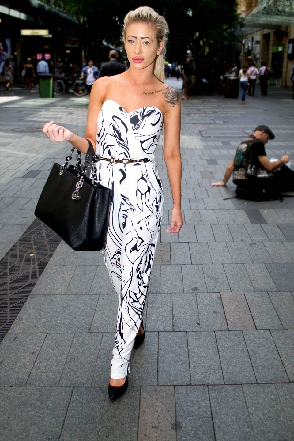 NSW: Ashleigh Candela, manager, snapped in Pitt St Sydney by Alice Sciberras.