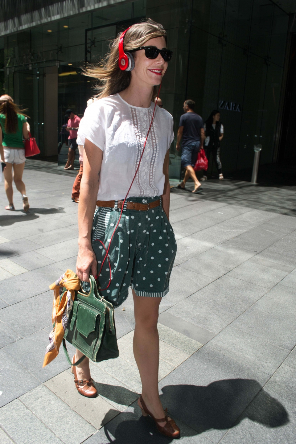 "Ruth Hannan, store director, snapped in Pitt St, Sydney. Photo: Alice Sciberras. ""I wear on trend quality vintage."""